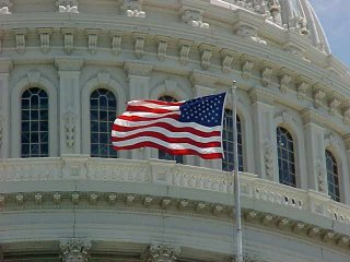US flag flying over the Capitol building in Washington DC