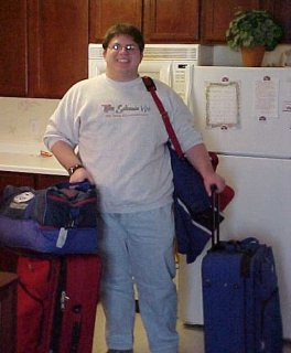 Ben Schumin holding lots of luggage