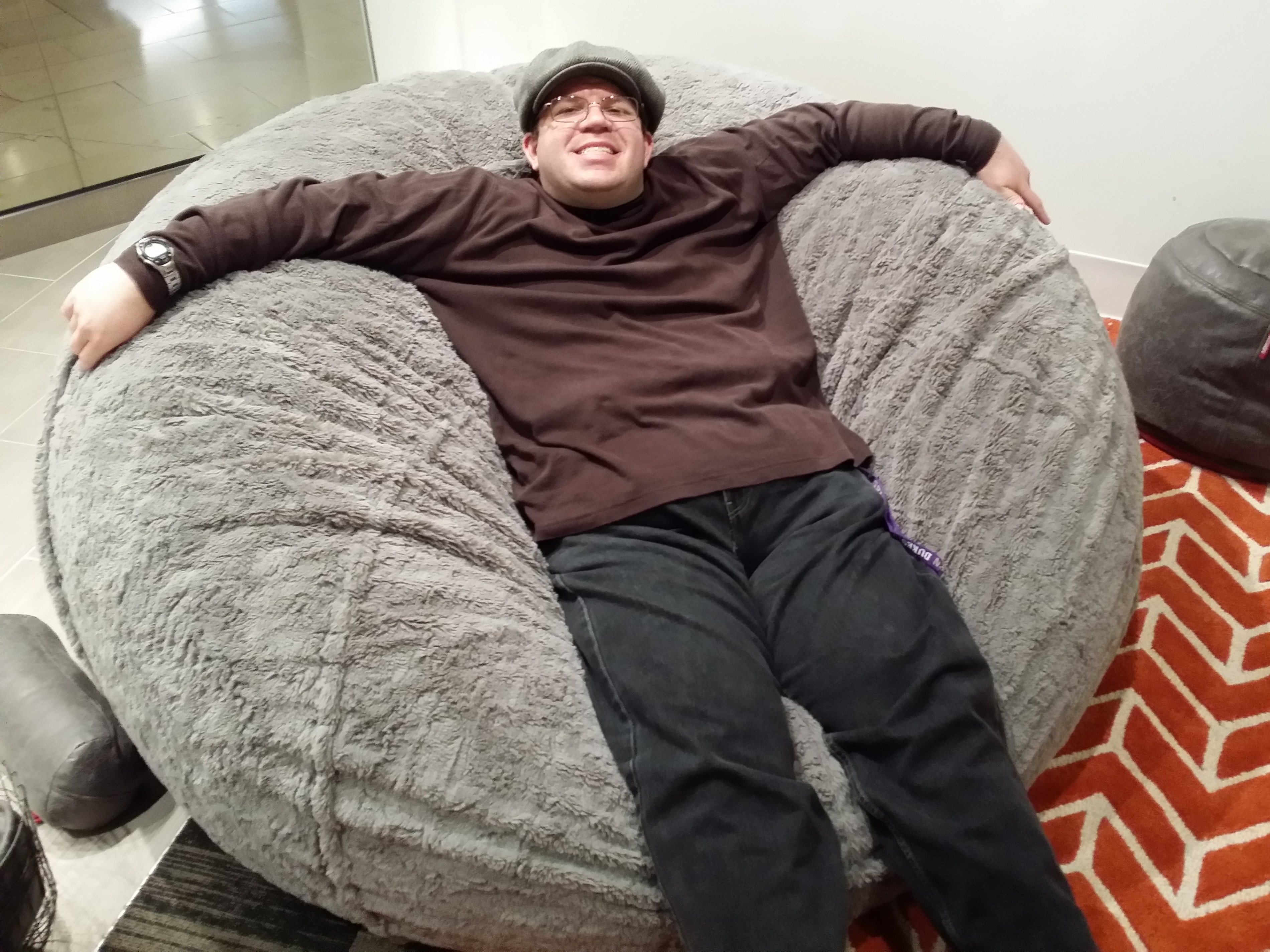 Laying Back On A Giant Beanbag Chair At LoveSac In Annapolis Mall