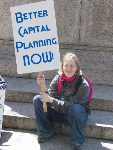 """Better Capital Planning NOW!"" sign"