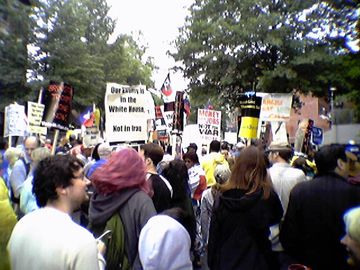 "Approaching Donald Rumsfeld's house. Police initially did not let the entire crowd through for purposes of crowd control, as Kalorama Road is not a particularly large street. The police eventually relented, and opened the gates. Meanwhile, we all began yelling, ""WHOSE STREETS? OUR STREETS!"""