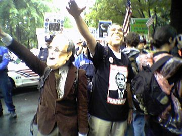 Some people really dressed up to make their point. These two wore masks designed to look like George W. Bush and Donald Rumsfeld, and likened them to Nazis by giving the Nazi salute while wearing the masks.