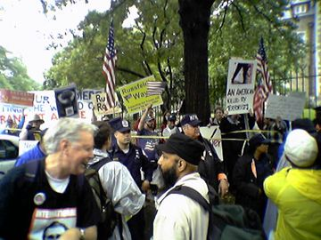 There was also a confrontation with a small group of counter-protesters that we met on Kalorama Road. These counter-protesters were in support of Bush, Rumsfeld, and the war, and were on the opposite side of the police lines from us.