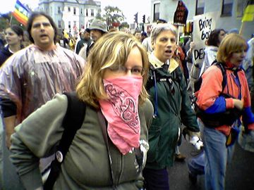 "We also encountered a number of masked protesters in the crowd, who went masked for various reasons. The girl in the pink bandanna actually commented to me, ""This is why I cover my face at these events,"" after I took her picture (with permission) during the march."