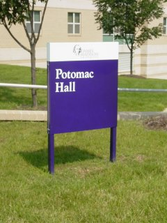 Purple sign in front of Potomac Hall. This was put in the summer before my third year in Potomac. Before that, we had a black sign.