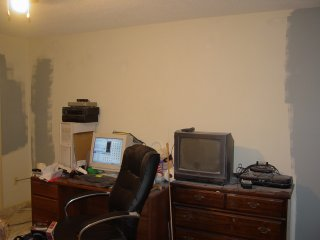 Same area, opposite wall. I'm working on the corner for the one wall, and the other end is done. Next area I do is the area behind the dresser. I do this because in order to do the area behind the bed, I need to move the bed to its new location, and the new location is in the corner. So I need to paint the area behind the dresser so that the area the bed will move to is finished so that I only have to move the bed once.