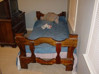 The bed is in its new home! Mom said I was nuts putting the bed against two outside walls. Of course, how convenient that she forgets that Sis's room is already done up that way, with her bed against two outside walls. But still, I like it. I have yet to sleep in the bed in this orientation, but it looks good. Plus I'm glad to see some furniture against a gray wall for a change. It looks GOOD. I also put outlet covers on the plugs that are next to the bed's location (they sell those in infants, not hardware, to my surprise). This way, I don't accidentally get my butt zapped, which I think is important.