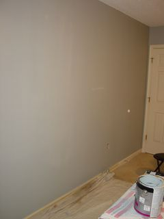 And this is the progress that I made today. See? That's the wall that the bed used to be. That was perhaps the worst part of the old paint job. You could tell prior to my painting that the wall was touched up in a number of places from old pictures on the wall, a couple of gashes that we had made when we dismantled the top bunk (that bed of mine used to be bunk beds), and whatever else. Either way, there was a lot of non-uniformity, as the original paint had become an off-color, and newer paintwork made for some striking non-uniformity. It looked bad, let's just say that. So now it's all clean and new looking again, with a uniform color in place. And the couch will go against this wall when I'm done, with my WMATA map hanging above it.