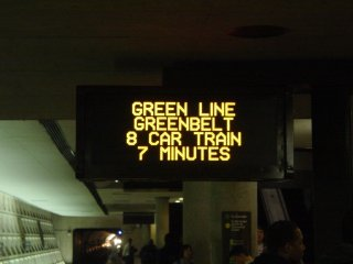 PIDS screen showing an eight-car Green Line train to Greenbelt.