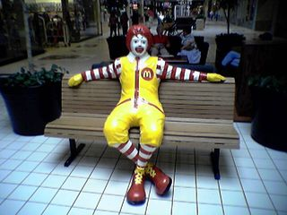 Ronald McDonald hogs one of the benches at Valley Mall