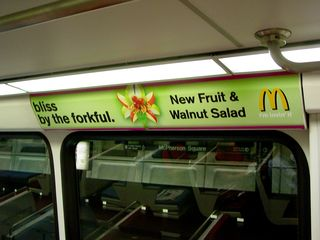 """CAF 5048-5049 wrapped in advertising for the McDonald's """"Fruit and Walnut Salad"""""""