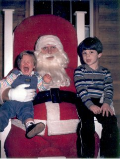 Sis and I sitting on Santa's lap in 1985