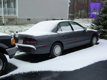 This is Sis's car, idle while she's at VT, also covered with snow.