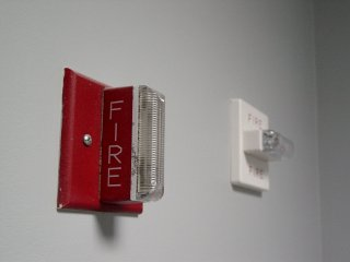 Two different fire alarm strobes, side by side