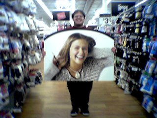 Holding a large picture of a woman