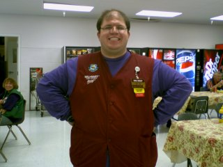 "Wearing the Residence Life ""purple shirt"" with my Wal-Mart vest"