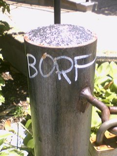 During the Borf graffiti spree, John Tsombikos had been busy, leaving tags along P Street (left) and Q Street.