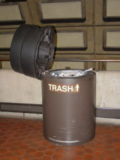 This would be a bomb-containment trash can, unattended with its lid up. I found it pertinent because it was brought up in the May 4 LunchTalk Chat with John Catoe, where he said he would pass the information on. Of course, the lid is there to further contain a potential explosion. The lid left up somewhat compromises this…
