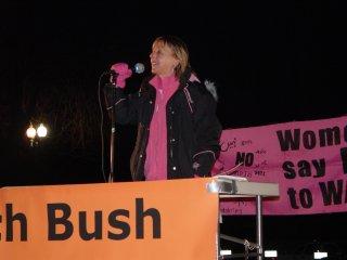 Medea Benjamin took the mic for a bit before Bush began speaking.