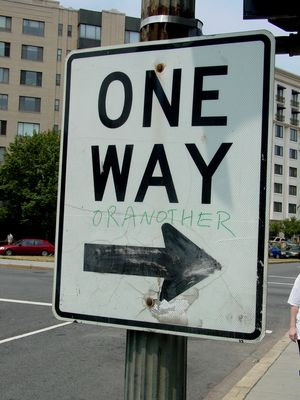 "One thing we encountered while walking up to Cafe Luna on P Street NW was this ""One Way"" sign at Scott Circle, which had been altered to read ""One way or another""."