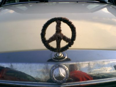 Mercedes logo turned into a peace sign