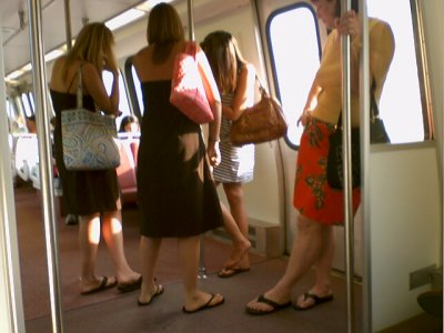 "Notice anything wrong here? The princess lost her shoe! I see eight feet and seven shoes. Looks like the girl in the stripes didn't ""mind the gap"" when this party boarded Breda 3072 at Crystal City."