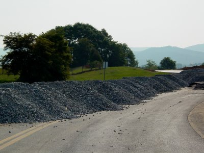 Gravel piles next to park and ride on old Shenandoah Village Drive alignment