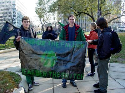 And as you can see, we had green and black flags at our march, as well as a banner.
