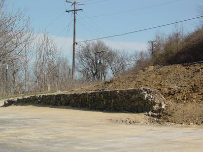 Some features, such as this retaining wall, were not demolished.
