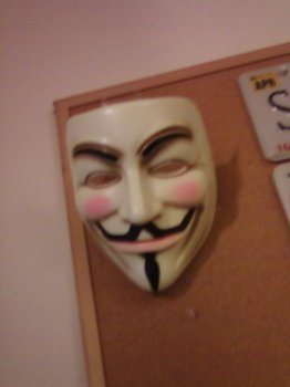 Guy Fawkes mask hanging from the wall