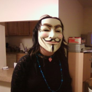 Isis' daughter tries on the Guy Fawkes mask