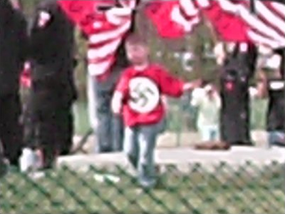 Child wearing swastika t-shirt