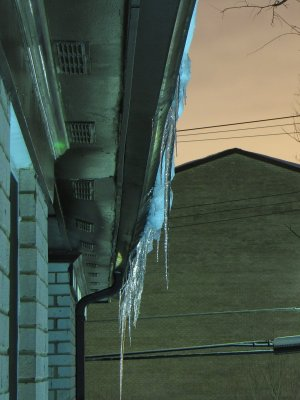 Icicles hanging from the roof of my apartment building.