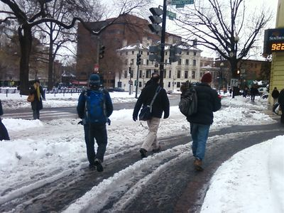 People walking through the U-turn area on Connecticut Avenue because the sidewalk wasn't clear.