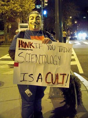 "Anonsparrow, meanwhile, held a large, laminated sign saying, ""SCIENTOLOGY IS A CULT"", and Purple Hair Anon worked the cars."