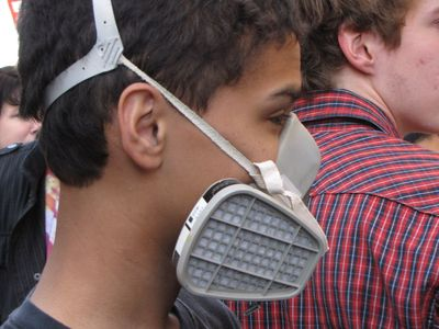 A teen wears a respirator at Funk the War 8.
