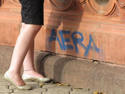 "Interestingly, a graffiti artist tagged the Founding Org prior to our raid, and so the mark of ""AERA"" was written in blue on the Org. ""Aera"" appears to be a local graffiti artist unconnected to Anonymous (though I'm sure that Scientology would love to blame it on us). And then that's Sadie standing next to the tag."