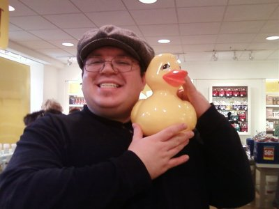 Holding up the rubber duck at Bath and Body Works