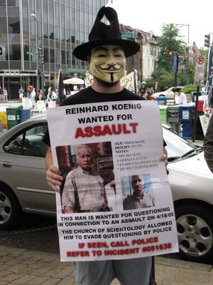 Meanwhile, Enturb held up a homemade wanted poster for Reinhard Koenig, the alleged kicker in the Ron Jeremy incident, who, at the time this photo was taken, was still at large.