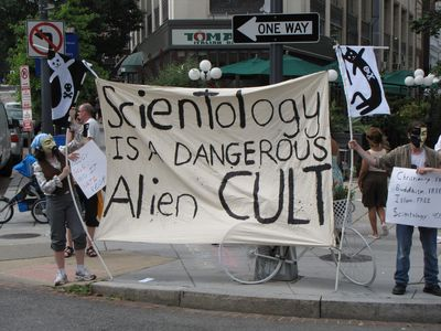 "This raid also marked the first time in about a year that we had a large banner. While our last banner in 2008 read ""BOOOO SCIENTOLOGY"", this one read, ""Scientology is a dangerous alien CULT""."