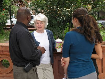 "Scientologists, including Founding Church of Scientology president Sue Taylor (center, with white hair) were out handing out their ""Anonymous Frequently Asked Questions"" flyers."