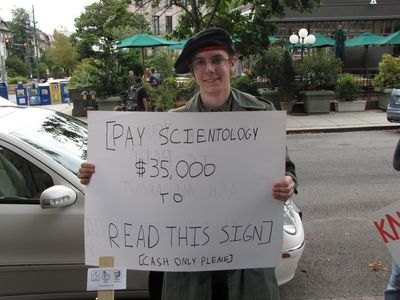 "Anyman went unmasked after learning that the Scientologists knew his name. He asked Sadie (aka ""Camera Girl"") if she knew his name, and she confirmed it, telling him his first and last name right on the spot. He was like, ""Yippee!"" and tore his Guy Fawkes mask off in short order, and then demanded his cease-and-desist letter. We'll see if he gets one. I got one, after all."