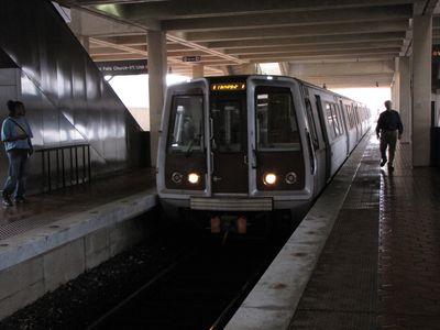 New Carrollton train arrives on center track.