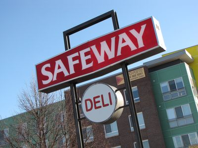 """Safeway"" sign at the corner of Georgia Avenue and Reedie Drive. I may be wrong, but the sign might not be original. The lettering on the sign doesn't appear to match the lettering on the building, which is what makes me think it's a later addition, or has otherwise been altered from its original form."