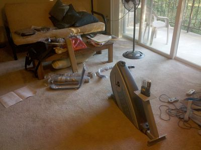 The exercise bike spread out around my living room, awaiting assembly