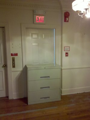 Fire exit deliberately blocked by a file cabinet