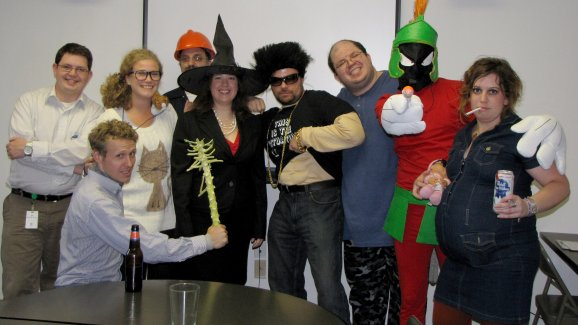 "We have, left to right, using character names, Bill Gates, Tim (holding the remains of a brussels sprouts plant), a crazy cat lady, a guy from Aperture Laboratories (from Portal), Christine O'Donnell, then a character that I don't recognize, me in ""weekend mode"" (wearing pajama pants and unshaven), Marvin the Martian, and a white-trash pregnant woman."