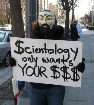 "MaidofWin carries the ""Scientology only wants your $$$"" sign that we first made for Richmond."