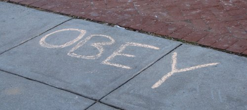 """OBEY"" in chalk"