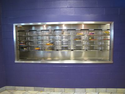 Changes to the tray return area to accommodate the elimination of trays.  The window is enlarged, and a plate hopper is added.